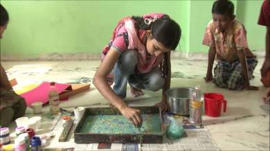 Neha a 9th grader doing marbling on bags for fund raising event.