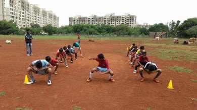 Kids doing warm up before a football match.