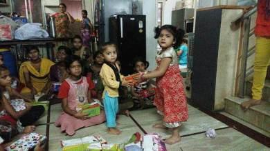 Our Field partners little kids donating footwear