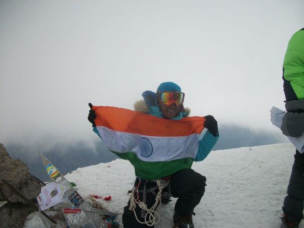 Jaahnavi with the National Flat on the top of Mt. Elbrus
