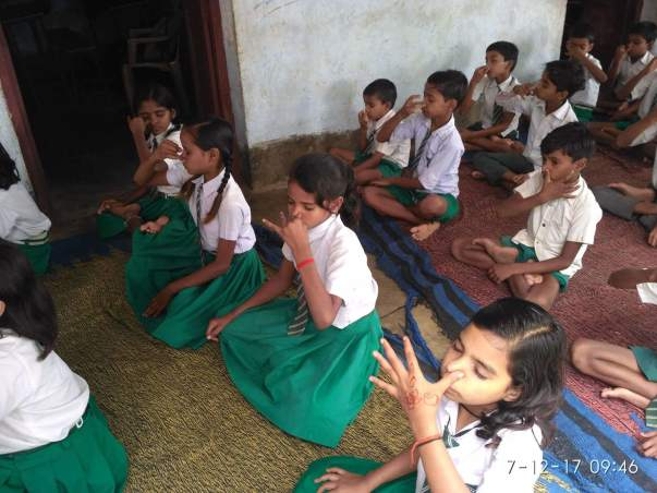 little school kids doing pranayam in yoga camp conducted by me