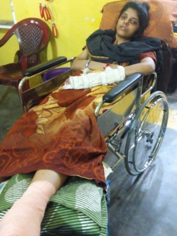 Hrudhaiyalakshmi in the folding chair, bought to her with the help of the funds raised.