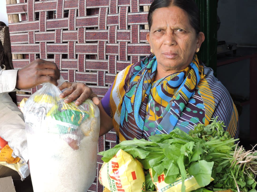 Elderly person in AndhraPradesh getting food support from NGO
