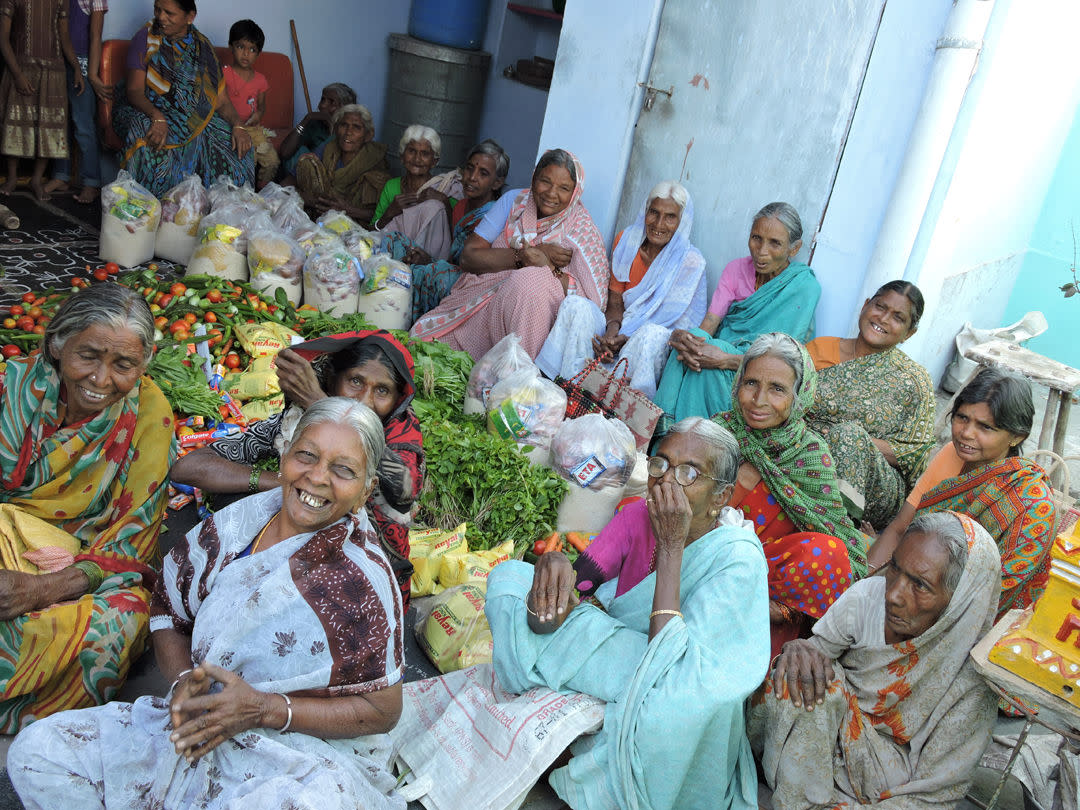 Elderly_Persons_getting_food_sponsorship_from_NGO_in_India