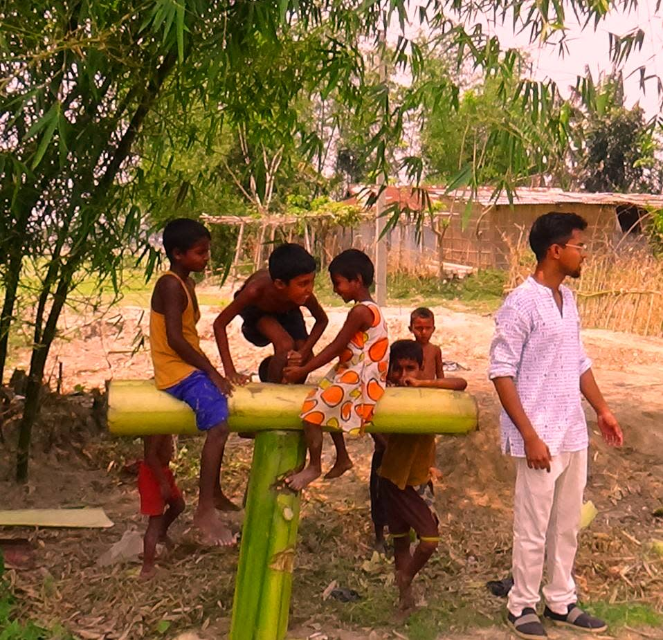 While conducting a case study on Absenteeism, I encountered these kids who instead of going to school were playing with this seesaw they made out of banana bark!