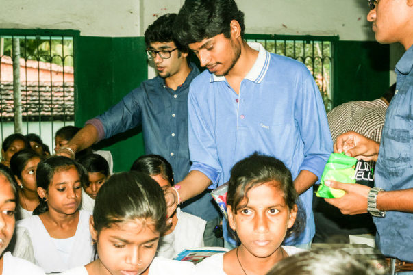Amit distributing chocolates at Halishahar Outreach