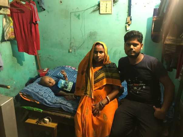 Atish with his father and 5 months pregnant mother