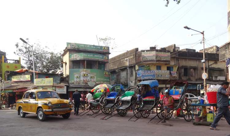Handheld rickshaws still ply in many parts of the city