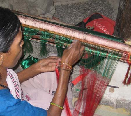 "The color change of silk pallu requires a join in the warp. The technique is called ""kondi"" or locking, The threads are hand tied on end by end - there are 5000 plus ends in the sari."