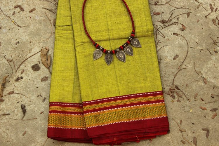 The fine fabric of a finished Ilkal sari for my mother with a matching piece of neckpiece.