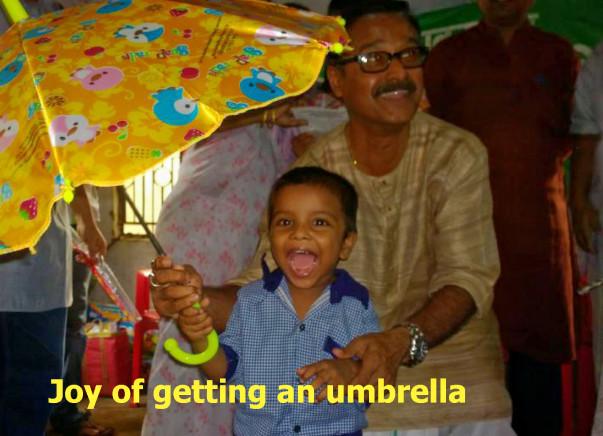 Free Distribution of Umbrella to slum dweller school children - 2017