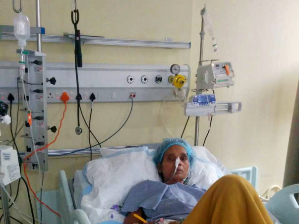 Help Meena Fight Cancer and Paralysis