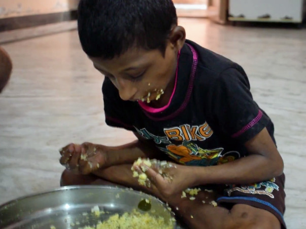 Serve Food For Homeless People And Mentally Challenged Orphanage Kids