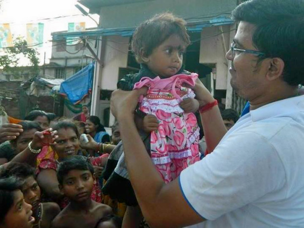 Clothes Distribution Among 4000 Needy Persons During Durga Puja