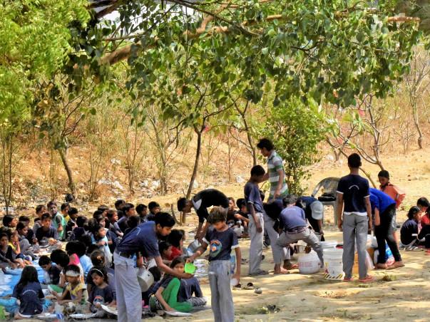 End child labour by feeding 150 slum area children everyday.