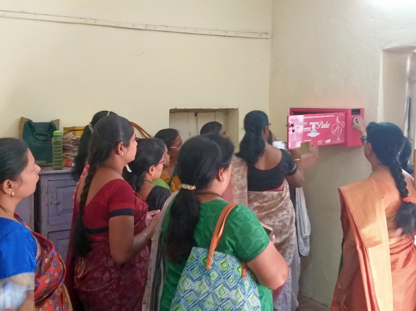 Donate for a sanitary pad vending machine in villages.