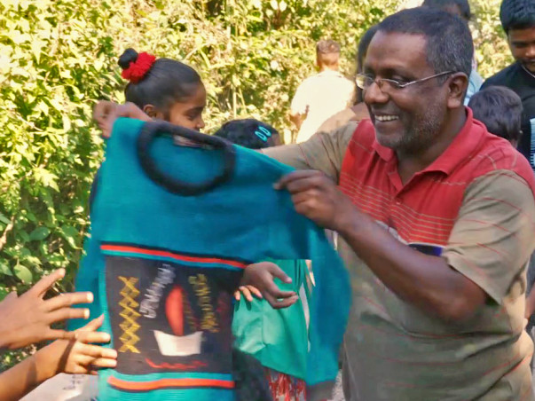 Support Saju Talukdar to distribute new and warm clothes