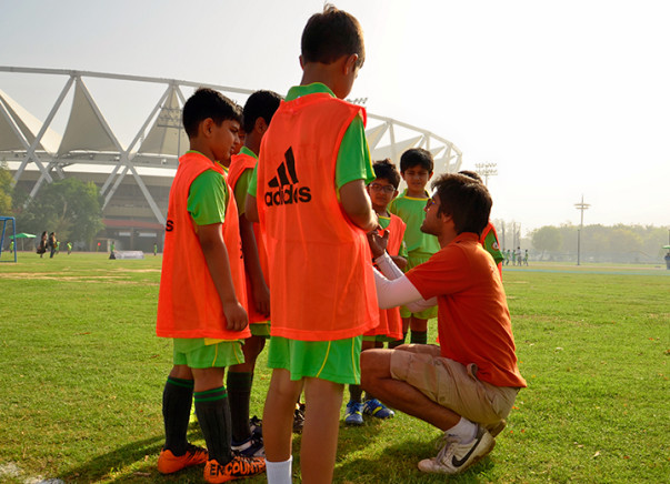 I am teaching football to create a safer society through sports