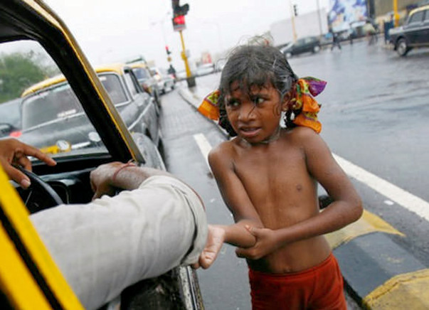 Poor children sleeping open on road join us in providing them clothes