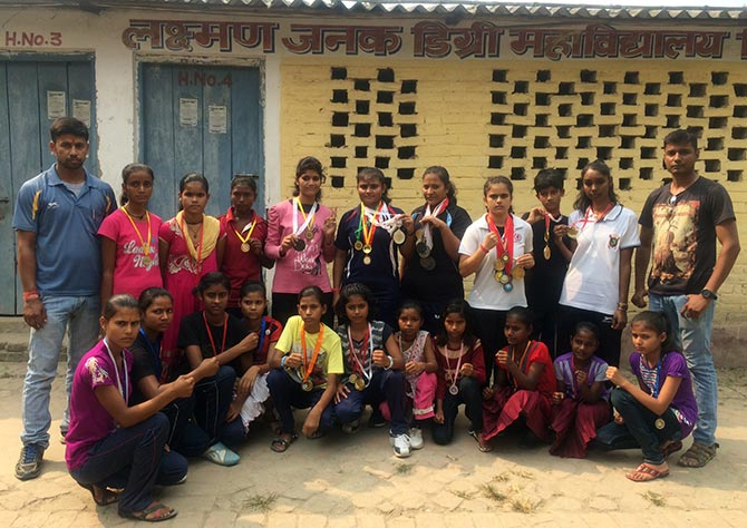 Girl boxers who have assembled from three schools that have started boxing classes. One is a government school. Coaches Roshan Singh, right and Dheeraj Kant, left.