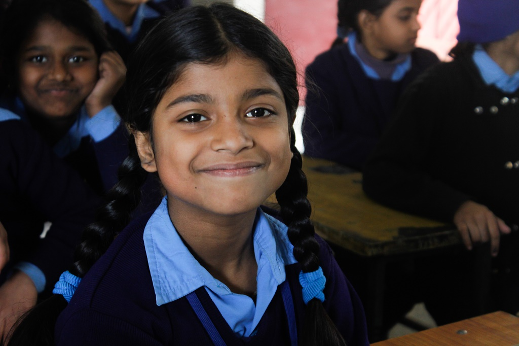 A student giving a sweet smile