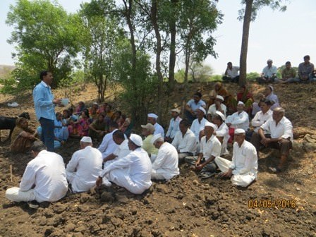 A view of meeting near the drinking water well with the village community